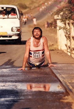 Marathon runner cooling off in puddle