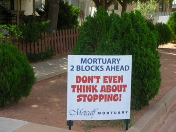mortuary marathon sign: don't even think about stopping